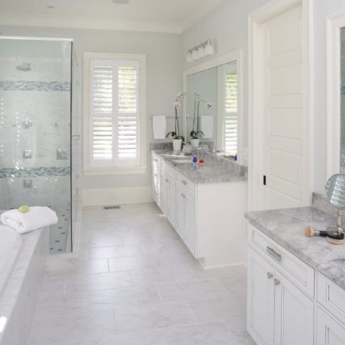 remodel contractors renovate master bathroom with white cabinets, walk-in shower, bathtub, and granite counters