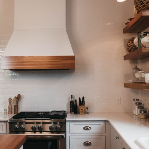 kitchen remodel contractors renovate cozy kitchen with white cabinets and wooden accents