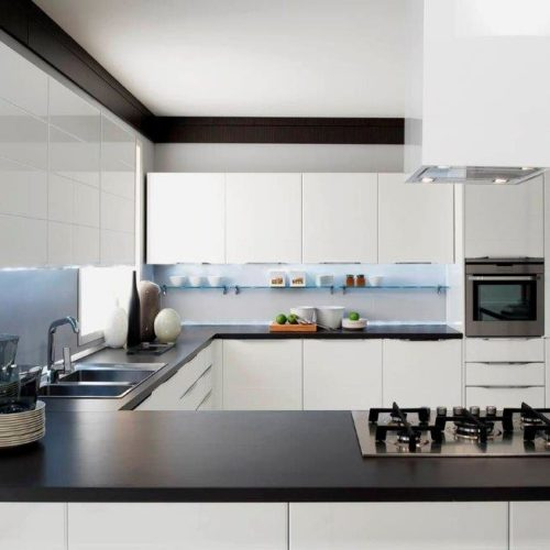 kitchen remodel contractors renovate modern, minimalist kitchen with white cabinets and black countertop
